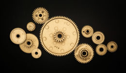 pile of golden gears on black background